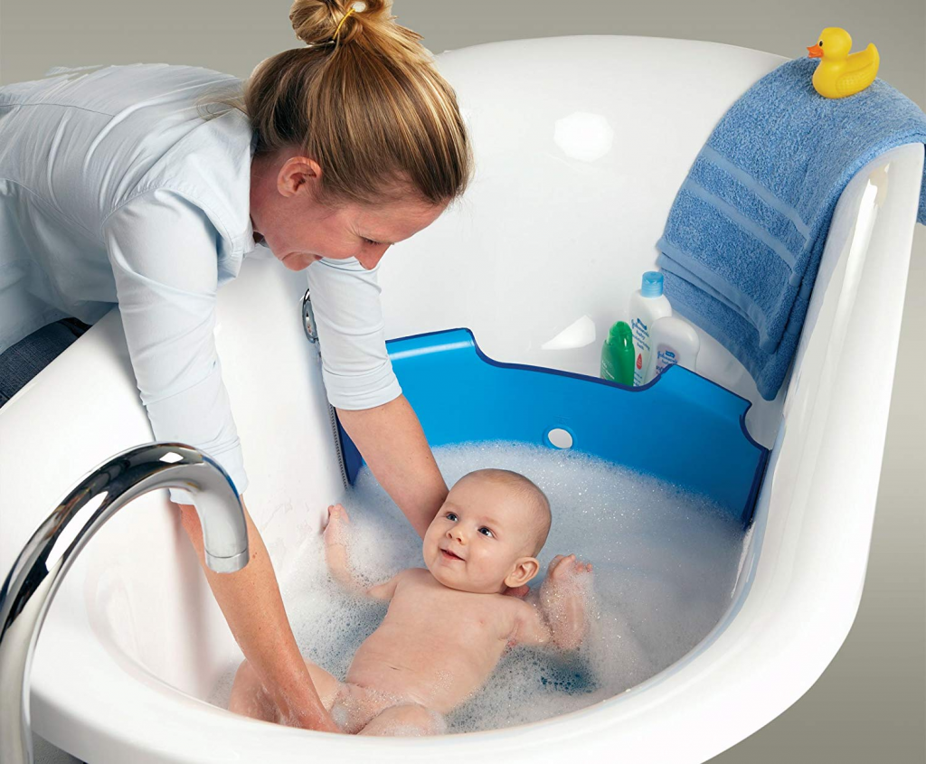 bathing baby using a bath damn